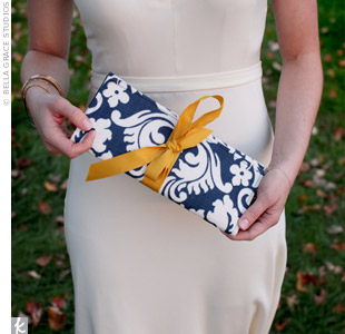 Catherine had a navy damask clutch custom-made by an artist on Etsy.com. Inside there was a personalized tag with the couple's wedding date. Catherine also gave each of the maids a clutch, but theirs fastened with a green ribbon instead of gold.