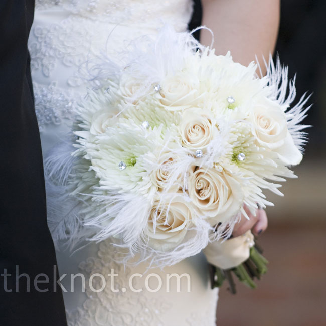 Lindsay's bouquet was made up of white and ivory roses, Fuji mums, and accented with ostrich plumes and rhinestones, creating an arrangement that was both classic and fun.