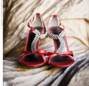 Lindsay's glamorous red satin shoes with crystal T-straps completed her look and matched the wedding's bold color scheme.