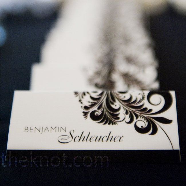 One of Lindsay's high school friends (now a graphic designer) created all of the couple's wedding stationery, including an intricate black-and-red swirl pattern, which appeared on the escort cards.