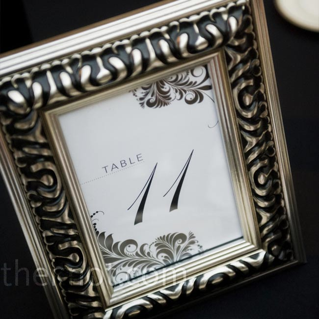 Framed table numbers added a formal touch to the reception décor and carried the motif of the rest of Lindsay and Steve's wedding stationery.