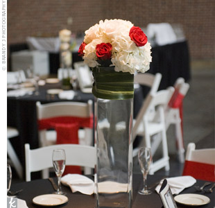 Five different centerpiece looks were used on the tables. Elements from these arrangements included: roses, Fuji mums, white hydrangeas, curly willows, manzanita branches, Monstera leaves, and hanging crystal drops.