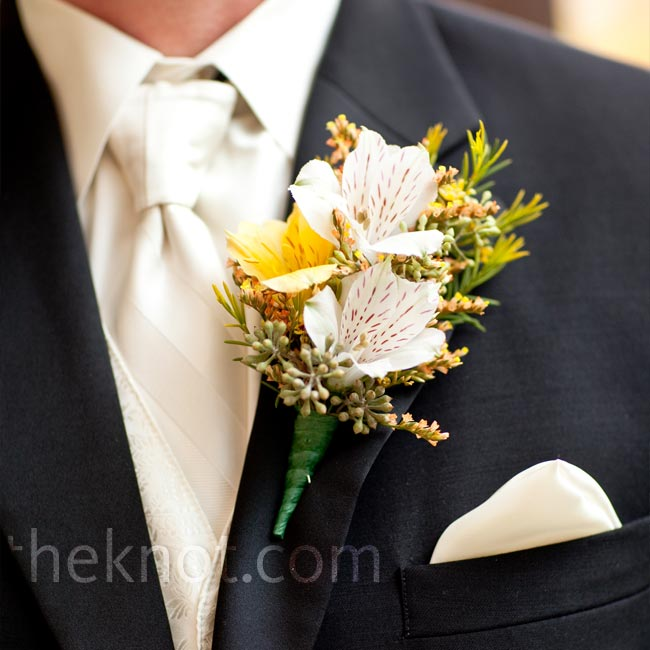 "Paul's boutonniere was designed with the same ""wild"" look that went into Shelly's bouquet with white alstroemeria and greenery."