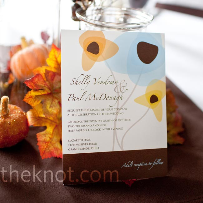 One of Shelly's bridesmaids designed all the wedding stationery, incorporating an abstract flower pattern on each element. Blue, orange, and brown set the tone for the rest of the wedding.