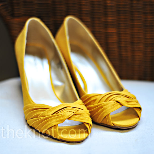 "Even though Tara knew she wanted yellow shoes, she had difficulty finding the perfect pair (she's almost 5'9"" and didn't want too high of a heel). She finally found it the week before the wedding."