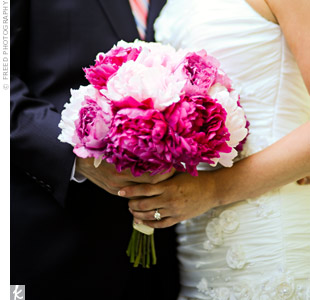 I love peonies, says the bride. She carried a gorgeous bouquet of fuchsia and pale pink peonies.