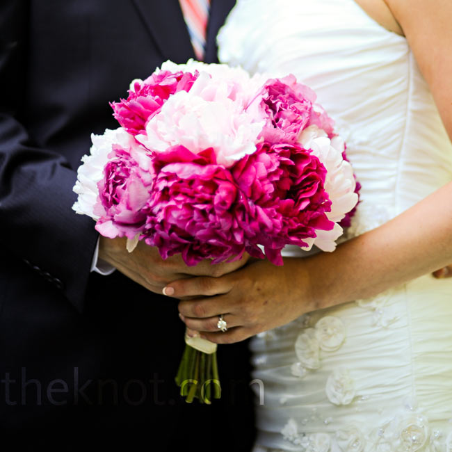 """I love peonies,"" says the bride. She carried a gorgeous bouquet of fuchsia and pale pink peonies."