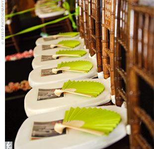 Apple-green paper fans, placed on each chair, helped guests stay cool during the ceremony.