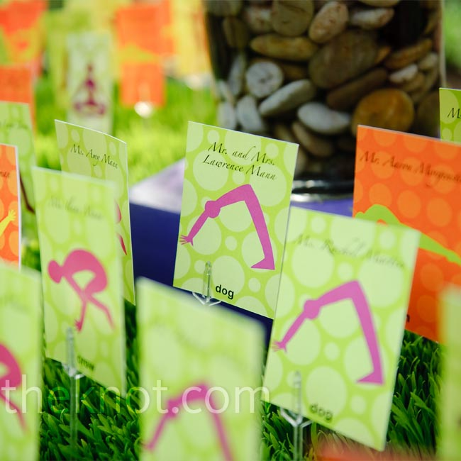 The bride and groom celebrated their love for yoga by naming each table after a pose and coordinating them with brightly colored escort cards, featuring the different poses.