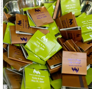 The bride and groom gave out personalized matchbooks in their wedding colors, with phrases like, Perfect match and Come on baby, light my fire.