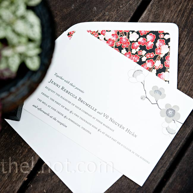 A crisp white invitation with a flowering branch motif invited guests to Jenni and Huan's stylish celebration.