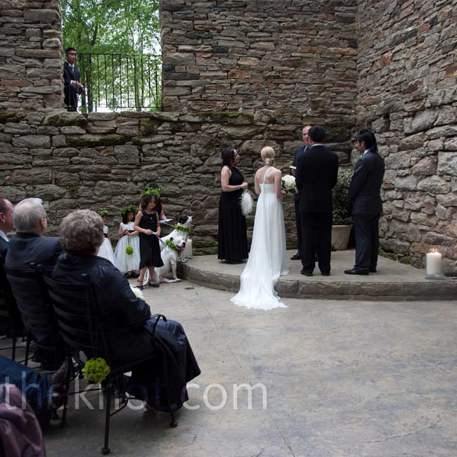 "Jenni and Huan exchanged vows inside an old gristmill that is partially intact, but open to the sky. ""It felt like a sacred space -- like ruins,"" says Jenni ""And we could hear the water flowing in the nearby creek!"""