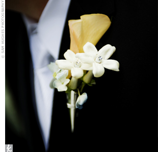 The groom wore a yellow calla lily cradled in three stephanotis blooms on his lapel.