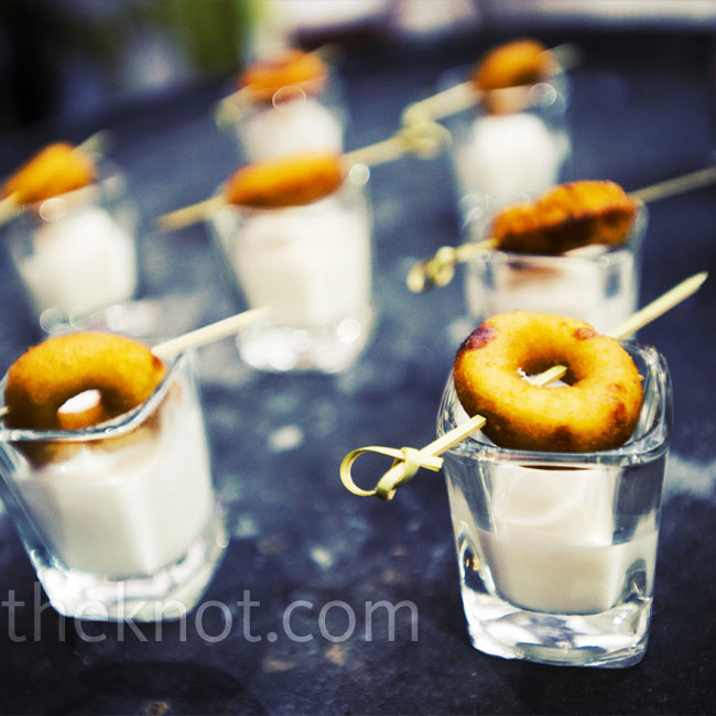 Toward the end of the reception, the bride and groom offered guests tasty mini-donuts served on a shot glass of milk.