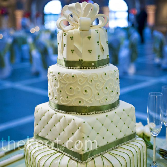 The bride and groom cut into a stunning four-tiered white-and-green cake. Each tier was a different geometric shape with a variety of stripes, dots and quilting. A white fondant bow draped over the top tier of the confection.