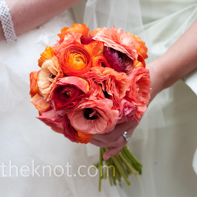 The bridesmaids carried bright bouquets of red, coral, and orange ranunculus. The matron of honor's blooms stood out with bursts of green mini hydrangeas.