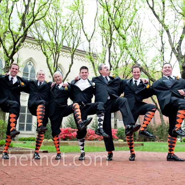 The groomsmen wore orange-and-black argyle knee socks (John's were ivory and black) as a wacky nod to the bride's time spent in Glasgow during graduate school.
