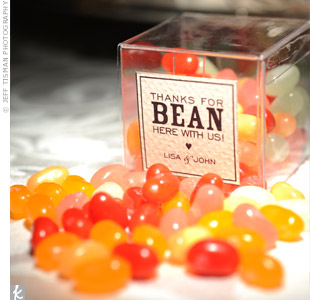 "Guests took home jelly beans in assorted colors that matched the wedding palette. The clear acrylic boxes were adorned with a label that read, ""Thanks for BEAN here with us!"""