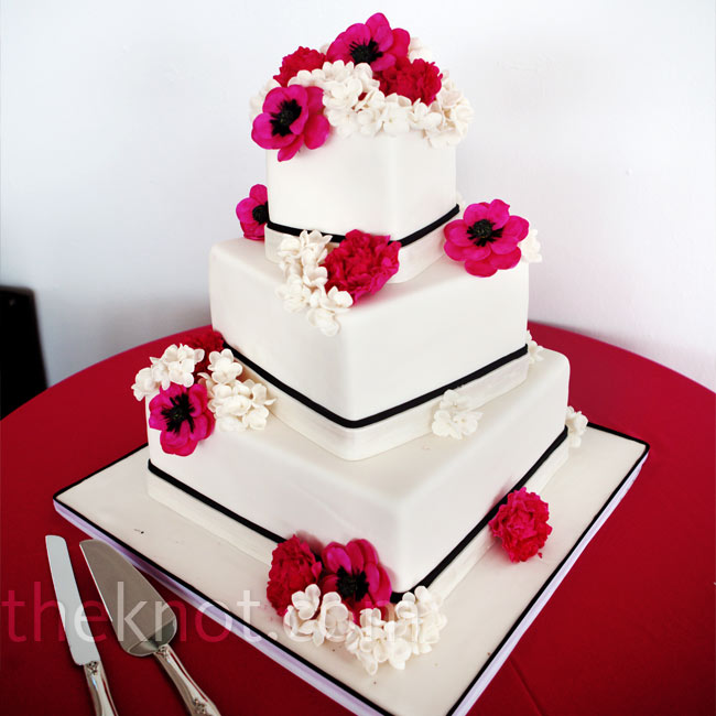 Cake designer Buddy Valastro (of TLC's Cake Boss, although the couple hired him before the show) created a white fondant treat, decorated with sugar flowers in the form of peonies and hydrangeas. The top tier was a white cake with lemon cream and fresh strawberries. The bottom two tiers were black and white cakes with hazelnut cream.