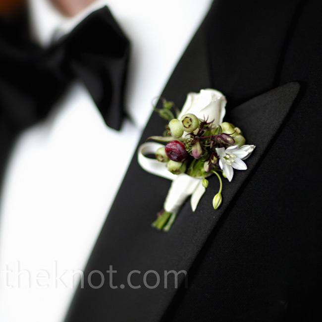 Wild berries added a playful touch to the simple white mini rose, which decorated the men's lapels.