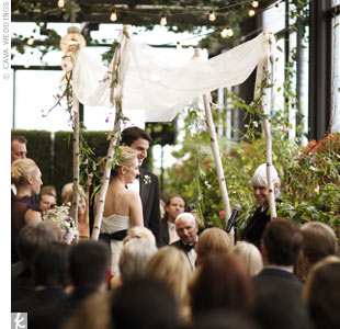 The couple wed under a natural huppah, made of tree branches, which tied in well with the garden aesthetic.