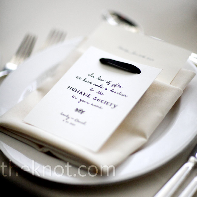 Carly and Daniel gave a charitable donation to the Humane Society instead of sending guests home with traditional favors. They let everyone know of the donation with notes, which rested atop each setting's menu card.