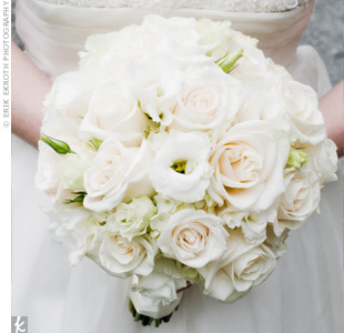 Cream and white flowers blended nicely against the bride's ivory wedding dress.