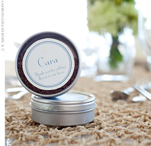 The favors doubled as place cards at each table, donning the guests name and a tagline that read, Thanks for adding flavor to our lives. Inside each tin was sea salt for guests to use in the kitchen.