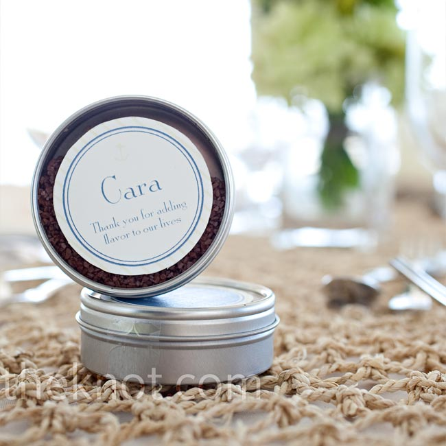 "The favors doubled as place cards at each table, donning the guest's name and a tagline that read, ""Thanks for adding flavor to our lives."" Inside each tin was sea salt for guests to use in the kitchen."