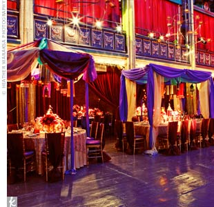 Tables were set up under Moroccan tents with hanging lanterns made from metal and beaded fabric. Warm candlelight created a comforting glow against the rooms jewel tones.