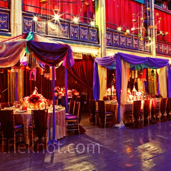 Tables were set up under Moroccan tents with hanging lanterns made from metal and beaded fabric. Warm candlelight created a comforting glow against the room's jewel tones.