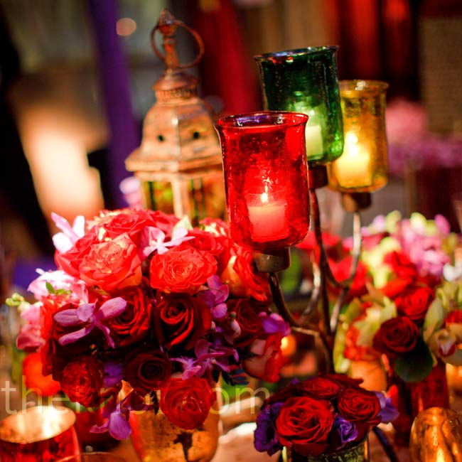 Red roses paired with low votive candelabras continued to add to the intimate ambiance.