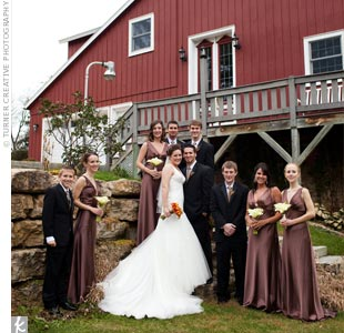 The bridesmaids wore floor-length chocolate brown dresses with a V-neckline that matched Maggies dress. Also to match Maggie, the girls accessorized with antique broaches that Maggie and her maid of honor found at various local antique shops. The groomsmen wore black tuxes and brown ties to coordinate with the girls.