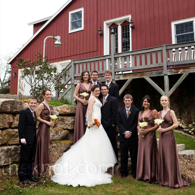 The bridesmaids wore floor-length chocolate brown dresses with a V-neckline that matched Maggie's dress. Also to match Maggie, the girls accessorized with antique broaches that Maggie and her maid of honor found at various local antique shops. The groomsmen wore black tuxes and brown ties to coordinate with the girls.