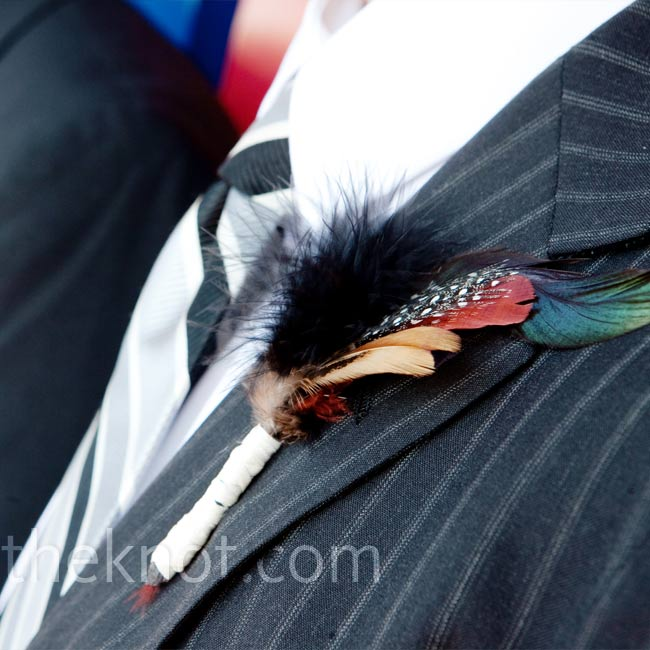 Patrick and his groomsmen wore handmade, feather boutonnieres, which matched the ones in the girls' hair.