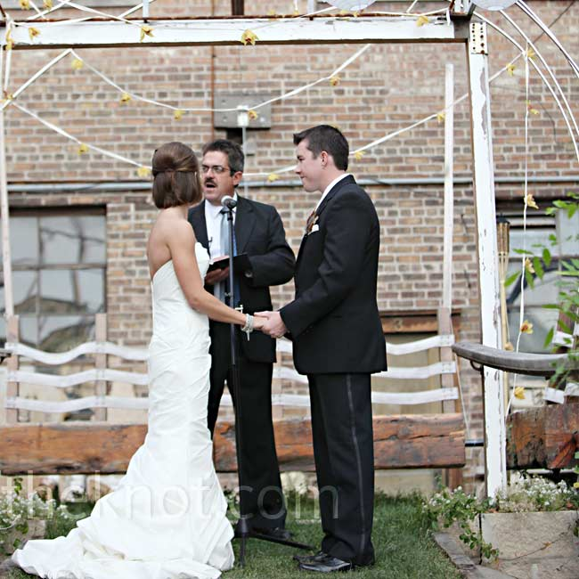 Megan and Patrick got married outside in the brick wall–enclosed courtyard at Salvage One in a quick, 15-minute ceremony.