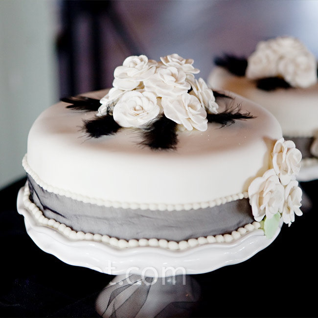 Patrick's mom made a set of three tiny, fondant cakes topped with black feathers and white sugar flowers. They also served some of their favorite desserts, such as cupcakes made by two of Megan's friends and cookies from Potbelly Sandwich Shop.