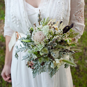 Katy carried an eclectic mix of pussy willows, lisianthus, fiddlehead ferns, dusty miller and cherry blossoms.