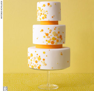 White wedding cake with orange and yellow polka dots by EatCakeBeMerry, EatCakeBeMerry.com