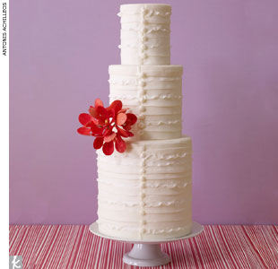 Ruffled white wedding cake accented with sugar buttons and red orchids by Cake Alchemy, CakeAlchemy.com