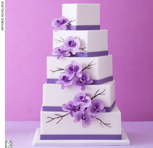 Square fondant cake stacked at an angle and accented with lavender bands and orchids by Mark Joseph Cakes, MarkJosephCakes.com
