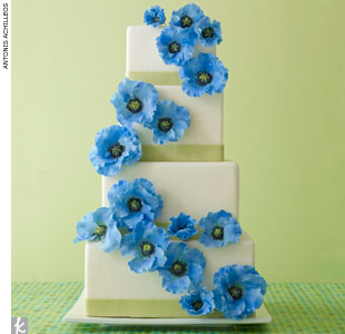 Four-tiered, square fondant cake accented with green fondant ribbon trim and bright blue sugar poppies by Ana Parzych Custom Cakes, AnaParzychCakes.com