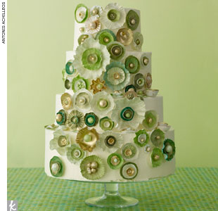 Buttercream wedding cake covered with hand-painted green and gold pottery and shell-inspired sugar accents by Nine Cakes, NineCakes.com
