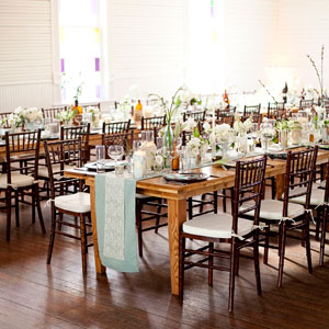 Katy and Daniel opted for long, banquet tables -- and didn't assign seats -- to get guests mingling. Warm lighting seeped through the hall's stained glass windows.