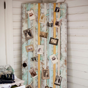 An old, distressed door was strung with ribbons and decorated with vintage family photographs.