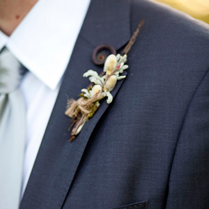 Daniel's rustic boutonniere was made with the same types of flowers as Katy's bouquet including pussy willow, dusty miller and a single fiddlehead fern.