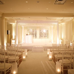 Kate and Matt wanted to leave the ceremony space as simple as possible, as to not detract from the important of marriage. The ballroom at The Plaza Hotel happened to be white so it was the perfect blank canvas they were looking for. They kept things simple with white chairs, white orchids and a white carpet aisle runner.