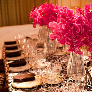 Kate isn't a big lover of flowers but she did love how the bright fuchsia orchid popped agains the black-and-white linens on the dinner tables. Other parts of the room were accented with vases of feathers.