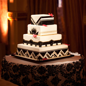 One guest from each table was invited up to help Kate and Matt cut their gorgeous Art Deco cake.