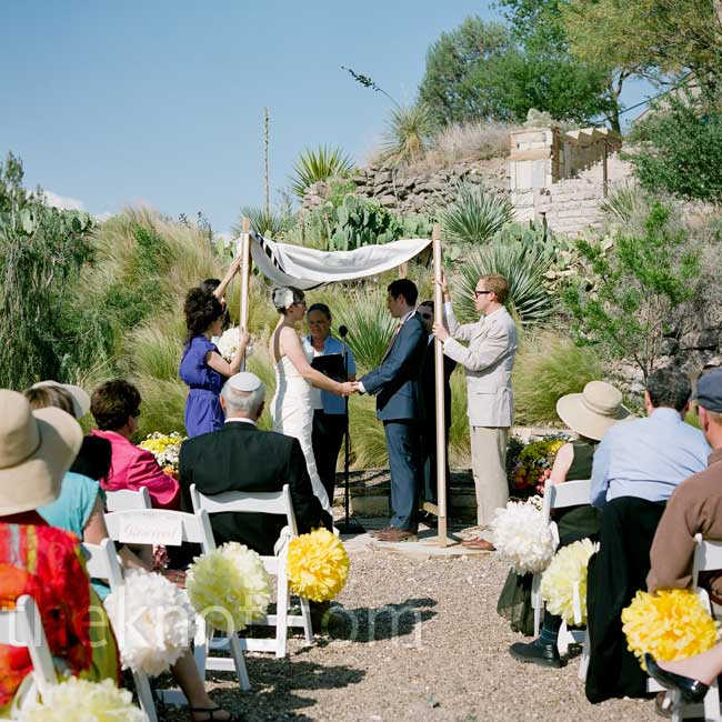 Even though the owner of House on The Hill had never had a wedding on his property before, he was extremely accommodating of the couple's request. Dan designed and built the huppah at a woodworking shop back home in Brooklyn from rift white oak that he had milled himself.